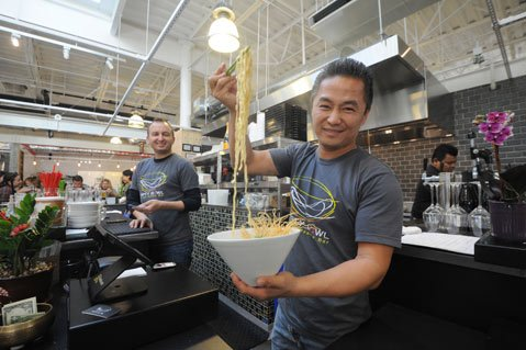 <b>NOODLING AROUND:</b>  Empty Bowl founder/co-owner Jerry Lee shows off the Northern Thailand Curry Noodle (Khoa Soi) at his popular S.B. Public Market noodle bar.
