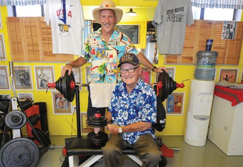 "<b>MUSCLE BOUND:</b> ""It was mostly acrobatics and gymnastics,"" said Larry Morris of the antics at Santa Monica's famous Muscle Beach. Larry was a regular in the '40s, hitchhiking almost 25 miles from the family home in Burbank to hang around weight lifters such as the legendary Steve Reeves. Muscle Beach closed in 1958 after a 24-year run, but Larry and his younger brother Steve (left) keep the memories alive thanks to a garage full of memorabilia that Steve has amassed."
