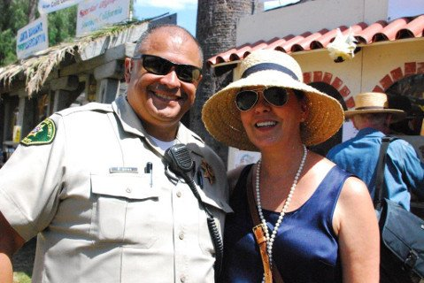 Bailiff Noel Rivas and Judge Denise de Bellefeuille await a tri-tip torta at El Mercado de la Guerra.