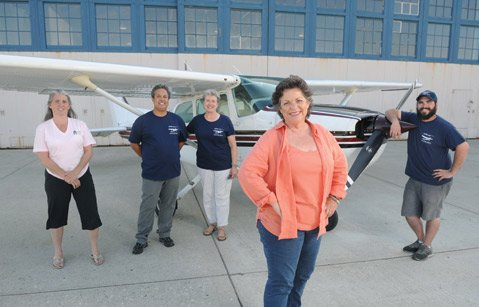 <b>BLUE-SKY MAKERS:</b>  The Different Point of View team includes (from left) Shawn Sullivan, Paul Phillips, Susan Hayes, Lynn Houston (owner), and Mike Linhart (Aug. 4, 2014)