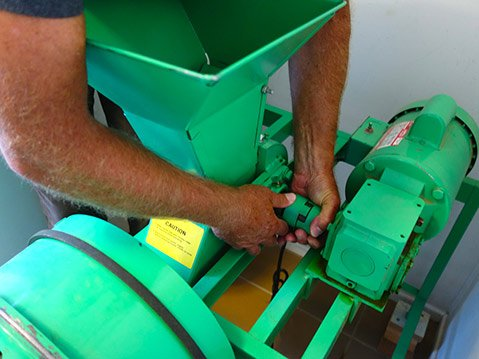 <b>ENTER THE FIXER:</b>  After months of the farm's nutshell cracker sitting idle, the author's husband, Monte, gets the broken machine going again.