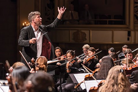 COMPOSER CONDUCTS:  Prolific British musician Thomas Adès was the maestro at Saturday's Academy Festival Orchestra concert.