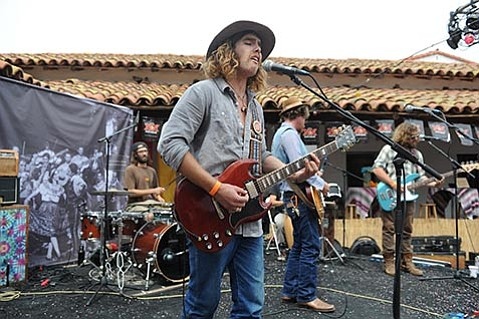 INDY LIVE:  Pacific Haze's Zach Doiron (center) hit all the right notes during the band's Fiesta set. This Thursday, August 14, the band plays as part of the first-ever Indy Live concert at SOhO