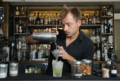 MIXING UP WINE COUNTRY:  After a day of making or sipping on the Santa Ynez Valley's fine wine, many vintners and their fans are turning to S.Y. Kitchen's Alberto Battaglini for a refreshing cocktail.