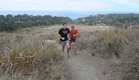 <b>LEGGING IT:</b>  Endurance runners Tyler Hansen (left) and Matt Dubberley test their mettle each year in two of the most difficult running events Santa Barbara has to offer: Nine Trails and Pier to Peak. Hansen won this year's Nine Trails.
