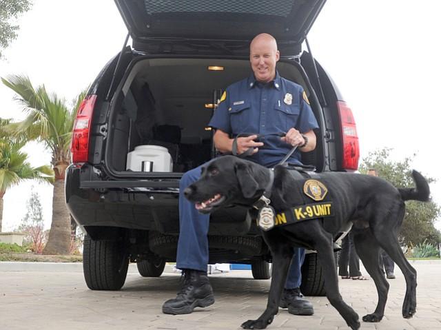 Captain Howard Orr and Riley the arson dog