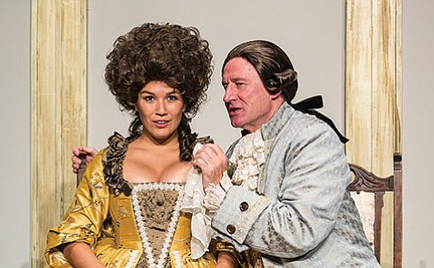GOT YOUR EAR:  Daniel Gerroll as Antonio Salieri whispers something confidential to Zoë Chao as Constanze Weber in Ensemble Theatre Company's production of Amadeus.