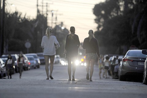 A group of young women walk through the streets of Isla Vista