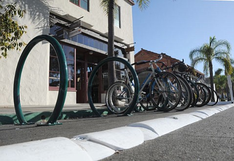 "Downtown Santa Barbara has its first ""bike corral"" located on the bike-intensive stretch of East Canon Perdido Street by Jimmy's Oriental Gardens and the Three Pickles sandwich shop."