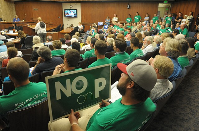 No on P supporters pack the county board room