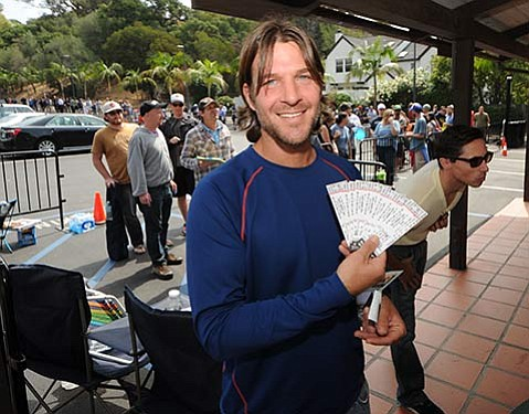 <b>SLEEPING WITH A PURPOSE: </b> When tickets went on sale in early August for this week's two-night stand by Phish at the S.B. Bowl, more than a hundred fans camped out in the wilds of Milpas Hill to score a highly coveted ticket or two. Despite the band's party-rich history and infamously festive fan base, the overnight ticket hang proved to be a markedly civil affair, complete with a fan-generated sign-in sheet and all sorts of shiny, happy people like Michael Glazer (top), who scored the first tickets sold.