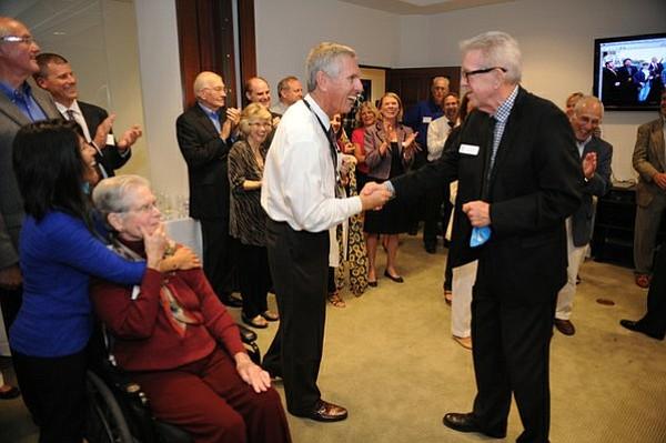 Superintendent David Cash (left) and Craig Price (right), Santa Barbara Education Foundation president, shake hands at the 30th anniversary celebration Thursday night.