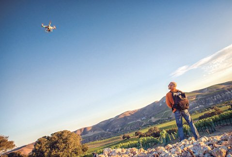 <b>TECHNO TRIUMPH:</b>  Former ad exec Wil Fernandez turned his marketing prowess to Santa Barbara wine country to produce a film-photo-podcast-tasting tour, employing everything from drones (as seen above) to photomacrography.