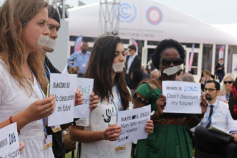 Young protesters at UN climate change conference in Lima, Peru, insisting that talks consider the fate of future generations.
