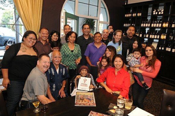"""Surrounded by family and friends, Agnes Guevara accepts """"The Izzy"""" Lifetime Achievement Award during The Independent's Fifth Annual Foodie Awards"""
