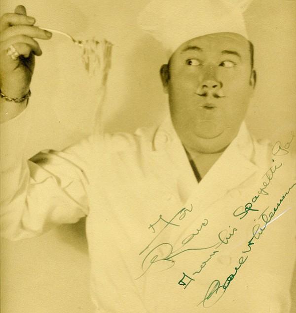 Band leader Paul Whiteman, clowning around in the kitchen