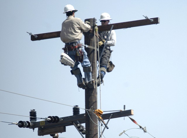 An Edison crew works to repair power lines