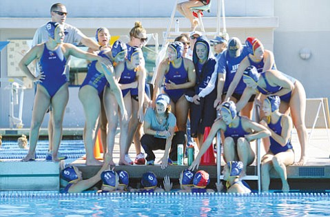 "<b>POOLSIDE PLANS:</b> ""I want us to have a championship mind-set and be able to win the Big West Conference,"" said UCSB head coach Serela Kay, who feels optimistic about the team's future. ""We have a lot of time to improve. We're going to be a different team in 12 weeks."" Kay (center) squats, surrounded by her water polo players."