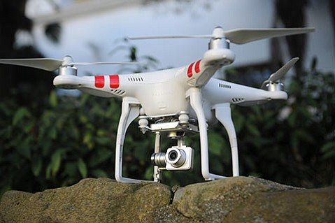 <b>TOOL OR TROUBLE?:</b> A Phantom quadcopter gets ready for liftoff.