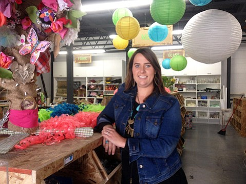 Lindsay Johnson stands in the remodeled Art From Scrap store at 302 East Cota Street.
