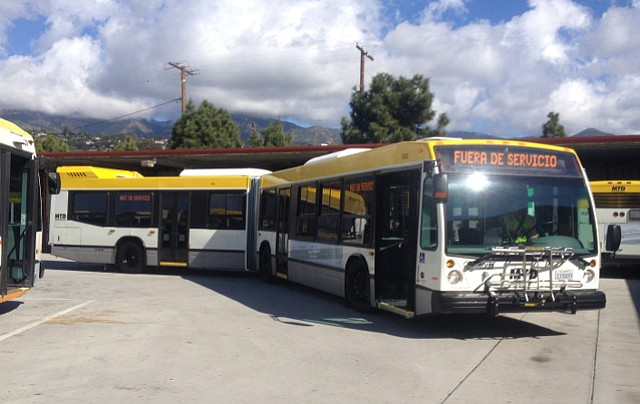 One of the three new articulated buses shows off its turning radius in the downtown MTD lot