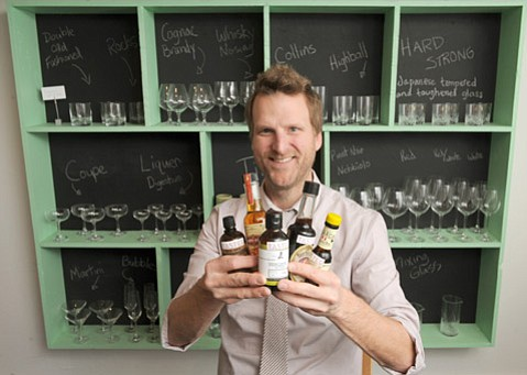 <b>HAPPIEST BITTER:</b>  Alongside vintage glassware, cool icepicks, and strainers galore, Jeremy Bohrer's new store on Anacapa and Ortega streets sells beaucoup bitters.