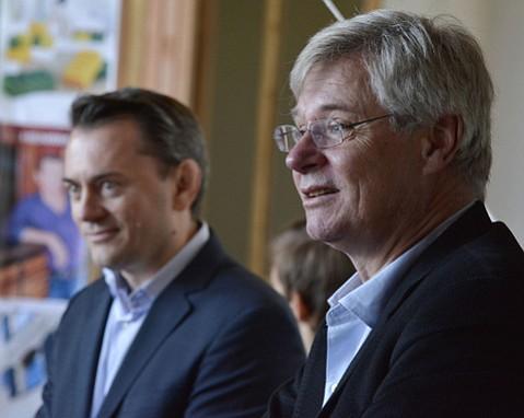 Peter Taksoe-Jensen, the Ambassador of Denmark to the United States, right, talks during the opening ceremony of the Copenhagen House with store owner Rene Kaerskov, left.
