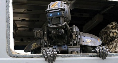 <b>I, CHAPPIE:</b>  Sharlto Copley voices the titular police droid reprogrammed to think and feel for itself in Neill Blomkamp's sci-fi fiasco.