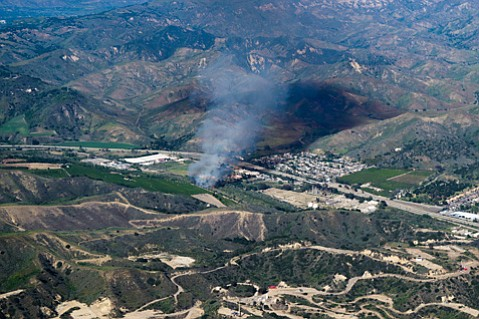 Flown by pilot Michelle Carter, photographer Josh Mead captured images of the brush fire just as it was beginning.