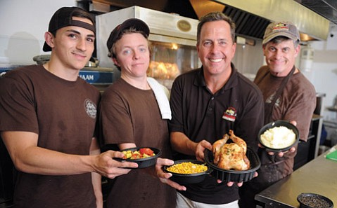 <b>POULTRY PROS:</b> The team behind Freeman's Flying Chicken includes (from left) Cole Freeman, Tyler Roche, founder Paul Freeman, and Jim LeVasseur.
