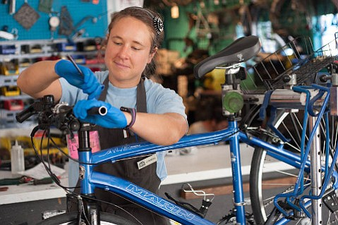 Lynneal Williams works on a bike at Bici Centro.
