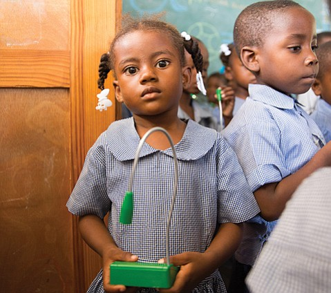 <b>BRILLIANT:</b>  Unite to Light's solar-powered LED lamps reach students in countries like Haiti (pictured), where kerosene powers the lights and produces soot and smoke.