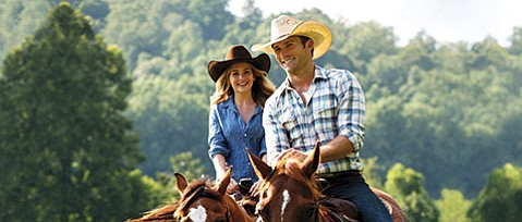 <b>LOVE AND RODEO:</b>  Britt Robertson (left) and Scott Eastwood star in the film adaptation of contemporary romance writer Nicholas Sparks's 2013 novel The Longest Ride.