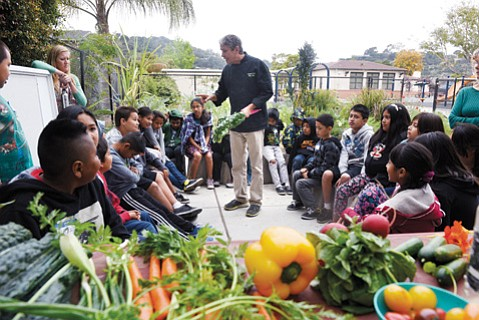 <b>FRESH AND FUN:</b> Harding School students learn about growing fresh food with instructor Claud Mann.