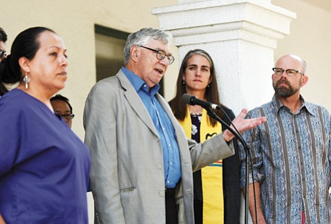 """<b>WHAT RECOVERY?</b>  Labor historian Nelson Lichtenstein (at microphone) detailed how wages have gone down—not up—despite the recovery and how Santa Barbara workers have been victimized by various forms of """"wage theft."""""""