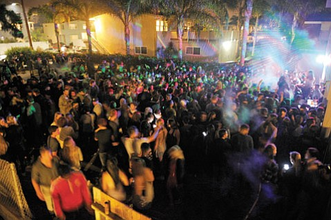 <b>BLASTED:</b>  Hundreds of partyers in the backyard of 6776 Del Playa Drive spill out onto Sabado Tarde Road.
