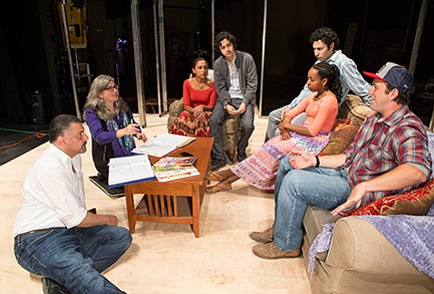 <b>COMING TO AMERICA:</b>  Playwright Yussef El Guindi (far left) and director Risa Brainin (second from left) work out the kinks with the cast of <i>The Talented Ones</i> during rehearsal.