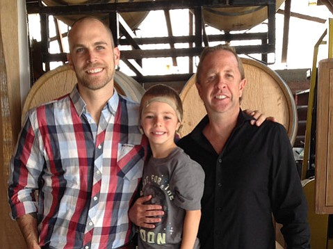 <b>HELP FOR FAMILIES:</b>  As founder of Look at Us, Rob Williams (right) is helping kids like Julian Veit (pictured with his father, Dan).