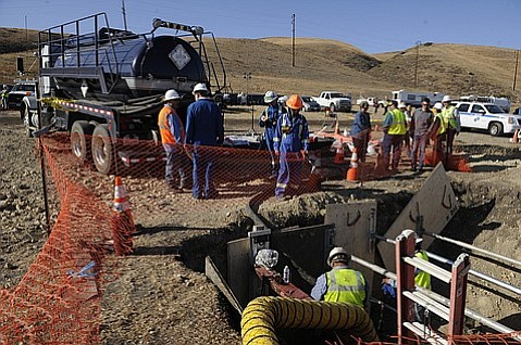 An exposed section of Plains All American pipeline near the break is worked on before the actual section of the break can be exposed. (May 22, 2015)
