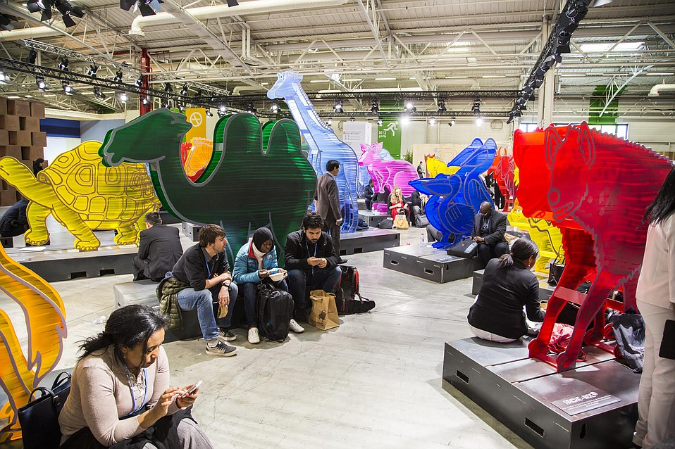 At Le Bourget, art and work swirl together as activists, officials, and others get busy with the work of trying to broker a deal.