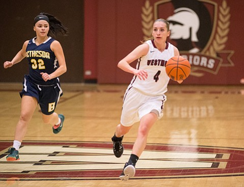 <strong>WESTMONT'S WOMEN STARS:</strong> Westmont College has a dynamic backcourt in senior Krissy Karr (#4) and freshman Kayla Sato (#10, pictured below).