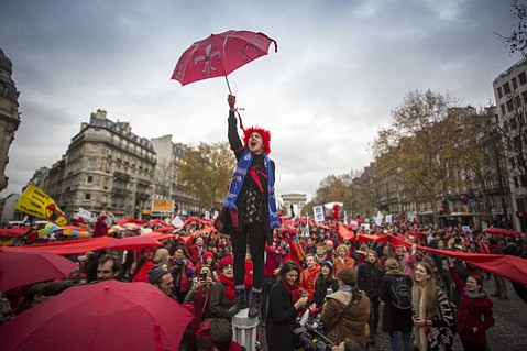 As the final draft of the Paris Agreement was being chewed on at Le Bourget, an estimated crowd of 15,000 activists and earth warriors took to the streets of Paris. Starting at the Arc de Triomphe at high noon, the group eventually reconvened at the Eiffel Tower late in the afternoon.