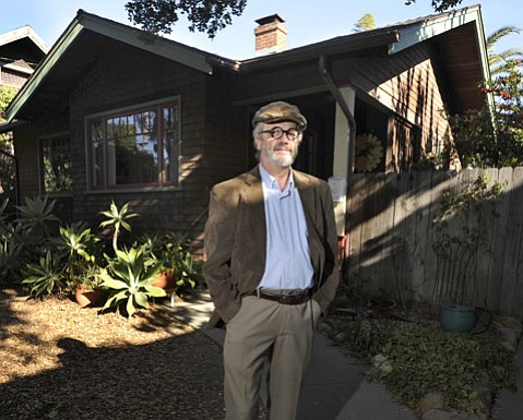 """<strong>PHASED OUT:</strong>  """"There's a plus side to short-term rentals,"""" said Eric Kelley, pictured with a vacation bungalow he operates with his wife, Peggy Lindt. """"Our downtown business [The Book Den] benefits tremendously from tourism. Short-term rentals allow middle-class families to come to Santa Barbara. As a businessman, I worry we're going to lose something there."""""""