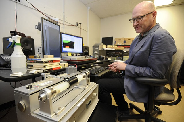 <strong>WAXING DIGITAL:</strong>  David Seubert, curator of the library's Performing Arts Collection, demonstrates the use of the library's Archeophone, which converts information in the grooves of wax cylinders into digital data.
