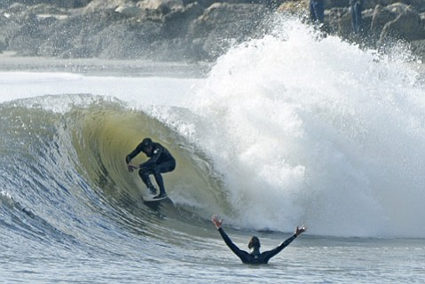 Big waves rolled in Thursday and brought surfers to Sandspit and surf photographers to the end of Stearns Wharf