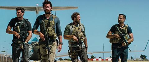 <b>THE HOURS:</b>  John Krasinski (second from left) plays Jack Silva in Michael Bay's <b>13 Hours</b>.