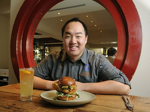 Chef James Siao with his Fried Chicken Sandwich.