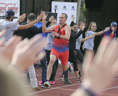 <strong>UP HIGH:</strong> Tom FitzSimons Jr. set a world record of 339 high fives in 60 seconds last Saturday morning at Westmont College, with the help of enthusiastic Santa Barbarans and tourists alike.