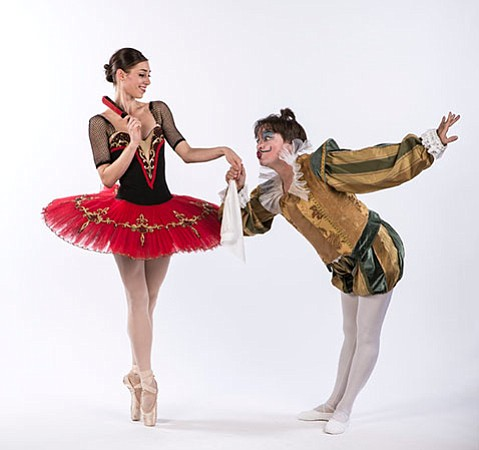 <b>FANTASTIC:</b>  Kitri (Kate Kadow) accepts the attentions of a masked reveler in State Street Ballet's <i>Don Quixote</i>.