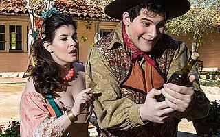 <b>PASSION POTION:</b>  Adina (Angela Mannino) looks on as Nemorino (Marco Cammarota) grips the bottle he believes will make her love him.